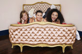 Teenage Girls on funky cushion bed — Stock Photo