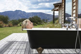 Woman taking bath on porch — Stock Photo