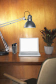 Laptop and other items on desk — Stock Photo