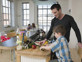 Son Helping Father — Stock Photo