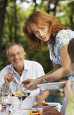 Mother serving food — Stock Photo