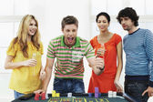 Man with friends celebrating gambling win — Stock Photo