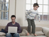 Father Using Laptop — Stock Photo