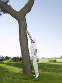 Golfer Retrieving Ball — Stock Photo