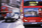 Red buses and black cabs — Stock Photo