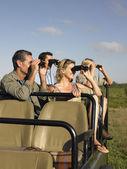 Group of tourists on safari — Stock Photo