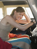 Woman at driver's seat of campervan — 图库照片