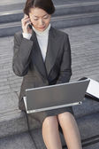 Businesswoman on outdoor Steps Using Laptop — Zdjęcie stockowe
