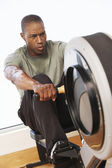 Man working out on Rowing Machine — Stock Photo