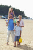 Vacationing Family on Beach — Stock Photo