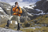 Hiker using walkie-talking — Stock Photo