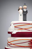 Comical bride and groom figurines — Stock Photo