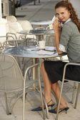 Businesswoman sitting — Stock Photo