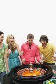 Friends winning on roulette wheel — Stock Photo