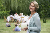 Woman Holding Lemonade at Family Picnic — Stock Photo