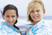 Children wrapped in towel — Stock Photo