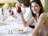 Woman at Dinner Party — Stock Photo