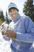 Man holding snowball — Stock Photo