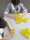 Schoolkids Playing with Dice — Stock Photo