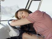 Woman Resting on Steering Wheel in van — Stock Photo