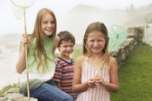 Children holding fishing nets — Stock Photo