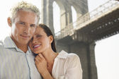 Couple embracing under Brooklyn Bridge — Stock Photo