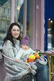 Mother with baby on her laps — Stock Photo
