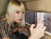 Woman Selecting CD — Stock Photo