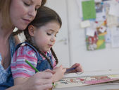 Mother Coloring With Daughter — Stock Photo