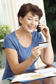 Woman paying credit card using cell phone — Stock Photo