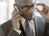 Businessman using phone — Stock Photo
