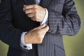 Businessman Adjusting Cuff Links — Stock Photo