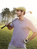 Golfer standing on course — Stock Photo