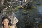 Woman Laying by Creek — Stock Photo