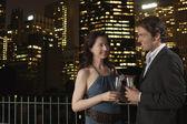 Elegant couple with champagne flutes — Stock Photo