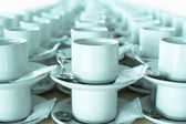 Stacked teacups and saucers — Stock Photo