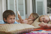 Three Children Relaxing — Stock Photo