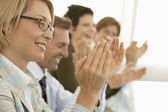 Businesspeople clapping in conference meeting — Stock Photo