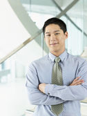 Confident Businessman standing arms crossed — Stock Photo