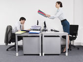Businesswoman passing off work to colleague — Stock Photo
