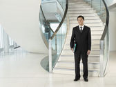 Confident Businessman in front of stairs — Stock Photo