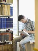 Student sitting on windowsill — Stock Photo