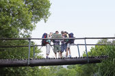 Teenagers reading map on bridge — Photo