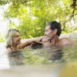 Couple embracing in pool smiling — Stock Photo #33850097