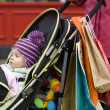 Baby sitting in stroller — Stock Photo #33850615