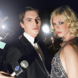 Couple posing in front of paparazzi — Stock Photo #33850685