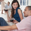 Couples drinking wine in living room — Stock Photo #33850853