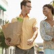 Stock Photo: Couple Walking with Groceries