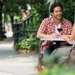 Couple drinking wine at sidewalk cafe — Stock Photo