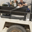 Couple sitting in back of car — Stock Photo #33851719